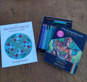Sacred Circle Coloring Book next to Prismacolor Pencil box.