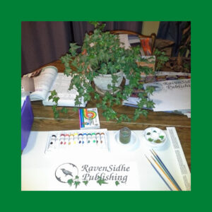 RavenSidhe Publishing logo being painted by hand.
